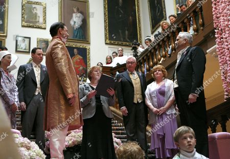 Pam Allen, Registrar for nearby Northampton conducts the civil partnership ceremony for Author Andrew Solomon and John Habich on the grand staircase at Althorp