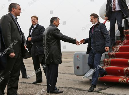 Sergei Naryshkin, Vladimir Konstantinov, Sergey Aksyonov Russian parliament speaker Sergei Naryshkin, right, shakes hands with the chairman of the Crimean parliament Vladimir Konstantinov at an airport outside Simferopol, as the head of Crimea's unrecognized Russian-backed government Sergey Aksyonov looks, at left. Russia annexed the Crimean Peninsula in March, but Ukraine and Western nations have rejected what they say is an illegitimate annexation