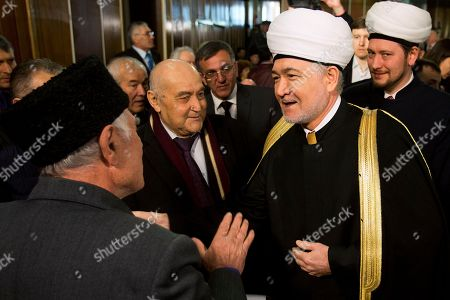 Crimean Tatars greet Russia's top Muslim Cleric Ravil Gainutdin, foreground right, during the Crimean Tatar Qurultay, a religious congress, in Bakhchysarai, Crimea, . The Crimean Tatar Qurultay, a religious congress will determine whether the Tatars will accept Russian citizenship and the political system that comes with it, or remain Ukrainian citizens on Russian soil
