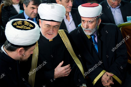Russia's top Muslim Cleric Ravil Gainutdin, center, talks with deputy chairman of Russia Muftis Council Rushan hazrat Abbyasov, left, and Mufti of Crimean Muslims Emirali Ablayev, right, during the Crimean Tatar Qurultay, a religious congress, in Bakhchysarai, Crimea, . The Crimean Tatar Qurultay, a religious congress will determine whether the Tatars will accept Russian citizenship and the political system that comes with it, or remain Ukrainian citizens on Russian soil