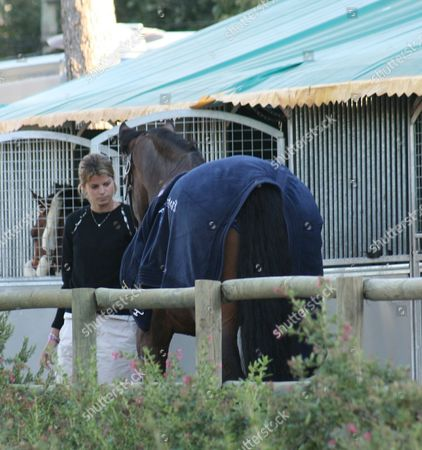 Athina Onassis with Doda Miranda's horse