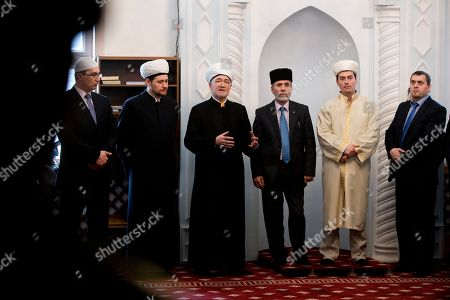 Ravil Gainutdin, Emirali Ablayev Russia's top Muslim Cleric Ravil Gainutdin, third left, with Mufti of Crimean Muslims Emirali Ablayev, third right, speaks after a prayer in a mosque in Simferopol, Crimea, . Ravil Gainutdin is in Crimea to attend Saturday's Crimean Tatar Qurultay, a religious congress that will determine whether the Tatars will accept Russian citizenship and the political system that comes with it, or remain Ukrainian citizens on Russian soil