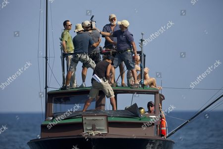 "Giovanni Ribisi, Adrian Sparks Actors Giovanni Ribisi, top left, and Adrian Sparks, top third right, work in the filming of the movie ""Papa"" in the bay of Havana, Cuba. Though the title derives from the Nobel Prize-winning novelist's nickname, the movie is based on an autobiographical script by Denne Bart Petitclerc, who is played by Giovanni Ribisi, while Hemingway is portrayed by theater and screen veteran Adrian Sparks"
