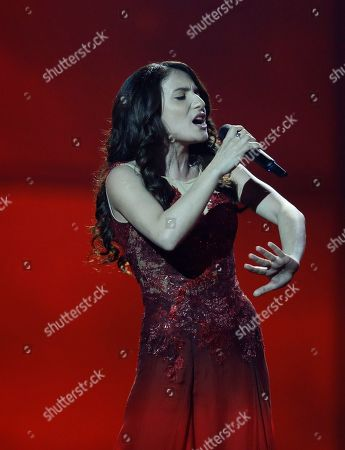 Stock Image of Singer Dilara Kazimova representing Azerbaijan performs the song 'Start A Fire' during the final of the Eurovision Song Contest in the B&W Halls in Copenhagen, Denmark