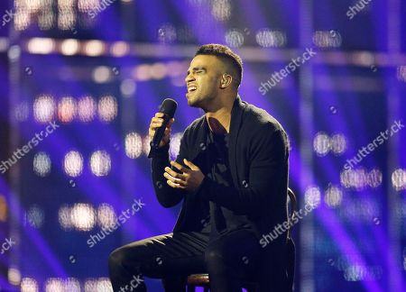Singer Andras Kallay-Saunders representing Hungary performs the song 'Running' during the final of the Eurovision Song Contest in the B&W Halls in Copenhagen, Denmark
