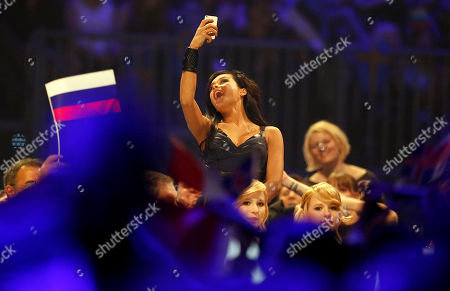 Singer Mariya Yaremchuk representing Ukraine takes a 'Selfie' beside a Russian flag after the first semifinal of the Eurovision Song Contest in the B&W Halls in Copenhagen, Denmark