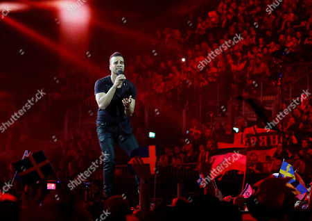 Singer Andras Kallay-Saunders representing Hungary performs the song 'Running', during the first semifinal of the Eurovision Song Contest in the B&W Halls, in Copenhagen, Denmark