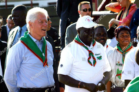 Former US. President Bill Clinton (L, front) and former Zambian President Kenneth Kaunda (R, front) watch a youth football match in Lusaka. Clinton visited Zambia on Saturday and he said there was need to increase the distribution of affordable anti-retroviral drugs (ARVs) to the countries affected by the HIV/AIDS pandemic.