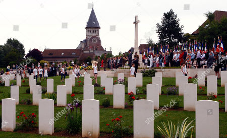 General view of the Military Cemetery at Fromelles (Pheasant Wood) during the Headstone Dedication for twelve Australian World War I soldiers identified, at the Fromelles (Pheasant Wood) Military Cemetery, in Fromelles, northern France, Saturday, July 19, 2014. The twelve Australians identified are: Private David Samuel Anderson 54th Battalion, Private Vinton Battam Baker 55th Battalion, Private Jack Marchmont Campbell 54th Battalion, Private William Thomas Connoly 54th Battalion, Private John Edwin Crocker 32nd Battalion, Private Willie Hilton Doust 54th Battalion, Private Frederic James Gleen 30th Battalion, Private Sidney John Gray 54th Battalion, Private Reginald Theodore Griffen 32nd Battalion, Private Adolf Thompson Knable 32nd Battalion, Private Joseph Edward Lee 60th Battalion, Private Archie McDonald 31st Battalion, Private Ernest Robert Olover 29th Battalion, Private Edgar William Parham 32nd Battalion, Private William Henry Christian Rose 55th Battalion, Private Gordon Thomas Smith 29th Battalion, Private Herbert Newey ST.Smith 32nd Battalion, Private Percy Weakley 31st Battalion, Private Albert Williamson 54th Battalion and Private Harold George Woodman 31st Battalion