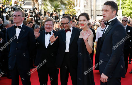 The cast of Leviathan, from left, actor Alexei Serebryakov, actor Roman Madianov, director Andrey Zvyagintsev, actress Elena Lyadova and actor Vladimir Vdovichenkov pose for photographers as they arrive for the awards ceremony at the 67th international film festival, Cannes, southern France