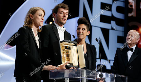From left, Claire Burger, Samuel Theis and Marie Amachoukeli pose after winning the Camera d'Or award for the film during the awards ceremony for the 67th international film festival, Cannes, southern France
