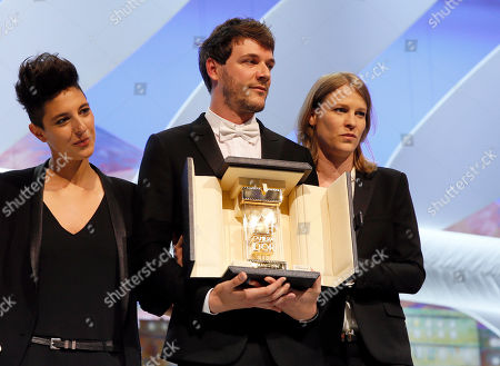 From right, Claire Burger, Samuel Theis and Marie Amachoukeli pose after winning the Camera d'Or award for the film during the awards ceremony for the 67th international film festival, Cannes, southern France