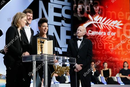 From left, Claire Burger, Samuel Theis and Marie Amachoukeli accept the Camera d'Or award for the film Party Girl during the awards ceremony for the 67th international film festival, Cannes, southern France