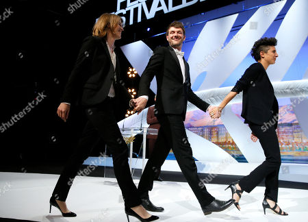 From left, Claire Burger, Samuel Theis and Marie Amachoukeli walk on the stage after winning the Camera d'Or award for the film during the awards ceremony for the 67th international film festival, Cannes, southern France