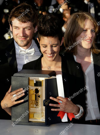 From left, Samuel Theis, Marie Amachoukeli, and Claire Burger pose after winning the Camera d'Or award for the film during a photo call following the awards ceremony at the 67th international film festival, Cannes, southern France