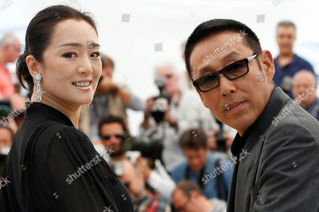 Actors Gong Li, left, and Chen Daoming pose for photographers during a photo call for Coming Home (Gu Lai) at the 67th international film festival, Cannes, southern France