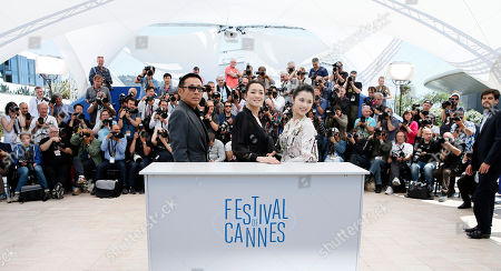 Gong Li, Chen Daoming, Zhang Huiwen From left, actor Chen Daoming, Gong Li, and actress Zhang Huiwen pose during a photo call for Coming Home (Gu Lai) at the 67th international film festival, Cannes, southern France