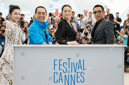 Gong Li From left, actress Zhang Huiwen, director Zhang Yimou, actress Gong Li and actor Chen Daoming pose during a photo call for Coming Home (Gu Lai) at the 67th international film festival, Cannes, southern France