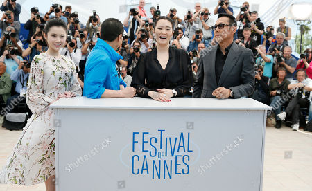 From left, actress Zhang Huiwen, director Zhang Yimou, actress Gong Li and actor Chen Daoming pose during a photo call for Coming Home (Gu Lai) at the 67th international film festival, Cannes, southern France