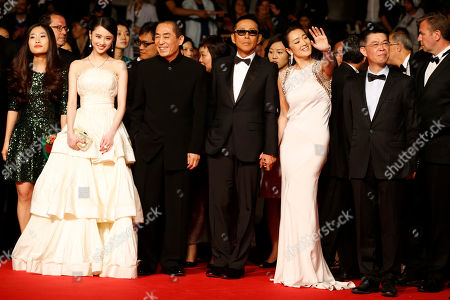From third right, producer Zhang Zhao, actress Gong Li, actor Chen Daoming, /director Zhang Yimou, and actress Zhang Huiwen pose for photographers as they arrive for the screening of Coming Home (Gu Lai) at the 67th international film festival, Cannes, southern France