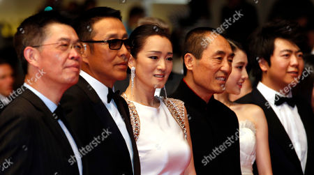 From left, producer Zhang Zhao, actor Chen Daoming, actress Gong Li, director Zhang Yimou, and actress Zhang Huiwen pose for photographers as they arrive for the screening of Coming Home (Gu Lai) at the 67th international film festival, Cannes, southern France