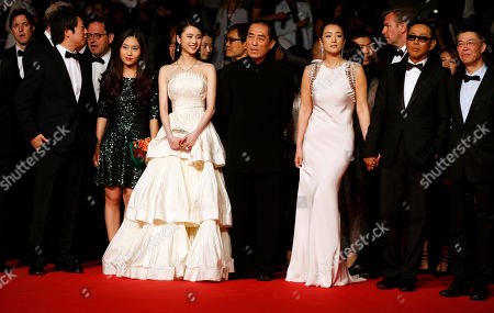 Actress Zhang Huiwen, third from left in front, director Zhang Yimou, center, actress Gong Li, third from right, actor Chen Daoming, and producer Zhang Zhao, right, arrive for the screening of Coming Home (Gu Lai) at the 67th international film festival, Cannes, southern France