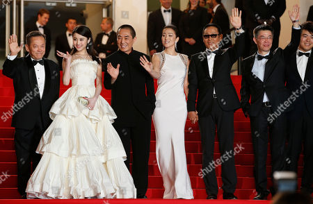 Actress Zhang Huiwen, second from left, director Zhang Yimou, third from left, actress Gong Li, center, and actor Chen Daoming pose for photographers as they arrive for the screening of Coming Home (Gu Lai) at the 67th international film festival, Cannes, southern France