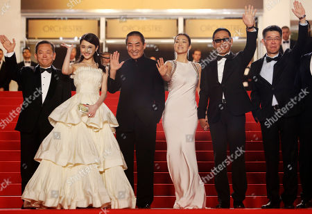 Actress Zhang Huiwen, second from left, director Zhang Yimou, third from left, actress Gong Li, center, and actor Chen Daoming, second from right, pose for photographers as they arrive for the screening of Coming Home (Gu Lai) at the 67th international film festival, Cannes, southern France