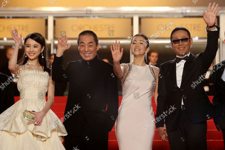 From left, actress Zhang Huiwen, director Zhang Yimou, actress Gong Li, and actor Chen Daoming for the screening of Coming Home (Gu Lai) at the 67th international film festival, Cannes, southern France