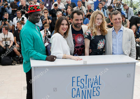 Stock Picture of From left, Moussa Toure, Geraldine Pailhas, President Pablo Trapero, Maria Bonnevie and Peter Becker pose for photographers during a photo call for jury of Un Certain Regard at the 67th international film festival, Cannes, southern France