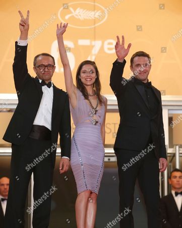 From left, director Andrey Zvyagintsev, actress Elena Lyadova and actor Vladimir Vdovichenkov pose for photographers as they arrive for the screening of Leviathan at the 67th international film festival, Cannes, southern France