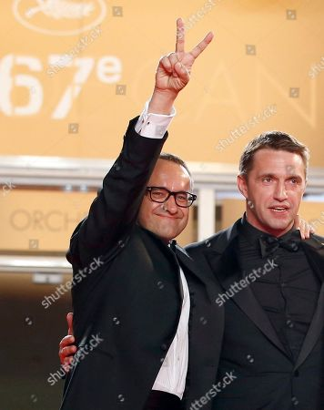Director Andrey Zvyagintsev, left, and actor Vladimir Vdovichenkov pose for photographers as they arrive for the screening of Leviathan at the 67th international film festival, Cannes, southern France