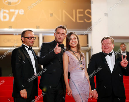 From left, director Andrey Zvyagintsev, actor Vladimir Vdovichenkov, actress Elena Lyadova, actor Roman Madianov pose for photographers as they arrive for the screening of Leviathan at the 67th international film festival, Cannes, southern France