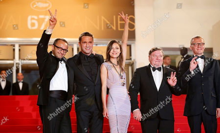 From left, director Andrey Zvyagintsev, actor Vladimir Vdovichenkov, actress Elena Lyadova, actor Roman Madianov, and actor Alexei Serebryakov pose for photographers as they arrive for the screening of Leviathan at the 67th international film festival, Cannes, southern France