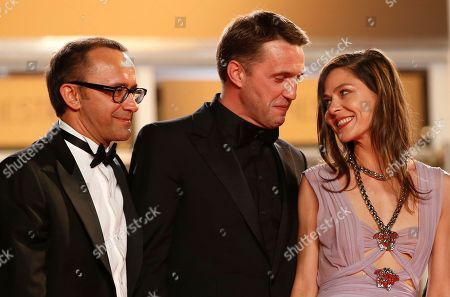 From left, director Andrey Zvyagintsev, actor Vladimir Vdovichenkov and actress Elena Lyadova pose for photographers as they arrive for the screening of Leviathan at the 67th international film festival, Cannes, southern France
