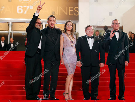 From left, director Andrey Zvyagintsev, actor Vladimir Vdovichenkov, actress Elena Lyadova, actor Roman Madianov, actor Alexei Serebryakov pose for photographers as they arrive for the screening of Leviathan at the 67th international film festival, Cannes, southern France