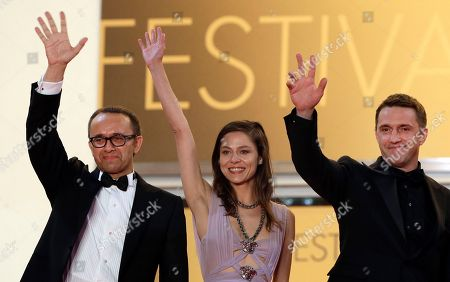 Director Andrey Zvyagintsev, left, actress Elena Lyadova, center, and actor Vladimir Vdovichenkov pose for photographers as they arrive for the screening of Leviathan at the 67th international film festival, Cannes, southern France