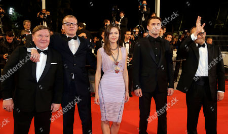From left, actor Roman Madianov, actor Alexei Serebryakov, actor Vladimir Vdovichenkov, actress Elena Lyadova and director Andrey Zvyagintsev pose for photographers as they arrive for the screening of Leviathan at the 67th international film festival, Cannes, southern France