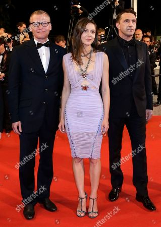 From left, actor Alexei Serebryakov, actress Elena Lyadova and actor Vladimir Vdovichenkov pose for photographers as they arrive for the screening of Leviathan at the 67th international film festival, Cannes, southern France