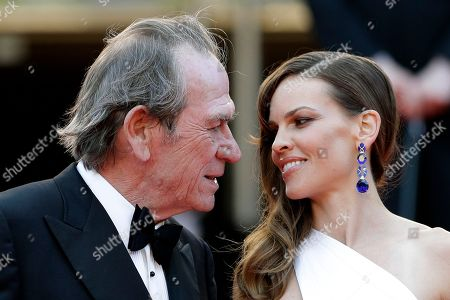 Director Tommy Lee Jones, left, and actress Hillary Swank speak as they arrive for the screening of The Homesman at the 67th international film festival, Cannes, southern France