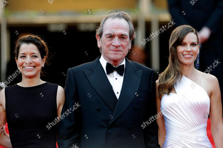 From left, Dawn Laurel-Jones, director Tommy Lee Jones, and actress Hillary Swank pose for photographers as they arrive for the screening of The Homesman at the 67th international film festival, Cannes, southern France