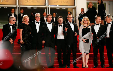 From left, Cannes film festival director Thierry Fremaux, producer Liz Watts, producer David Linde, actor Robert Pattinson, director Robert Michod, actor Guy Pearce, actress Susan Prior, actor Anthony Hayes, and an unidentified person pose for photographers as they arrive for the screening of The Rover at the 67th international film festival, Cannes, southern France