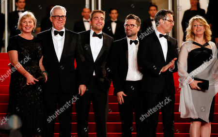 From left, producer Liz Watts, producer David Linde, actor Robert Pattinson, director Robert Michod, actor Guy Pearce, and actress Susan Prior pose for photographers as they arrive for the screening of The Rover at the 67th international film festival, Cannes, southern France