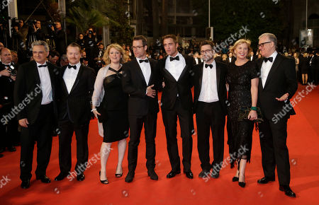 From second left, actor Anthony Hayes, actress Susan Prior, actor Guy Pearce, actor Robert Pattinson, director David Michod, producer Liz Watts and producer David Linde pose for photographers as they arrive for the screening of The Rover at the 67th international film festival, Cannes, southern France