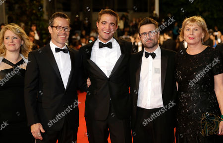 From left, actress Susan Prior, actor Guy Pearce, actor Robert Pattinson, director David Michod and producer Liz Watts pose for photographers for the screening of The Rover at the 67th international film festival, Cannes, southern France