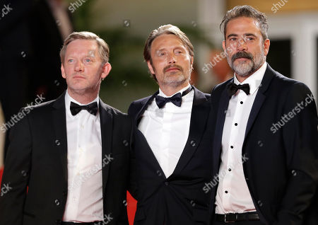 From left, actor Douglas Henshall, actor Mads Mikkelsen, and director Kristian Levring pose for photographers as they arrive for the screening of The Salvation at the 67th international film festival, Cannes, southern France