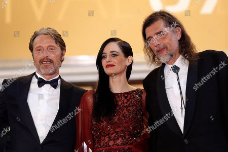 From left, actor Mads Mikkelsen, actress Eva Green and director Kristian Levring pose for photographers as they arrive for the screening of The Salvation at the 67th international film festival, Cannes, southern France