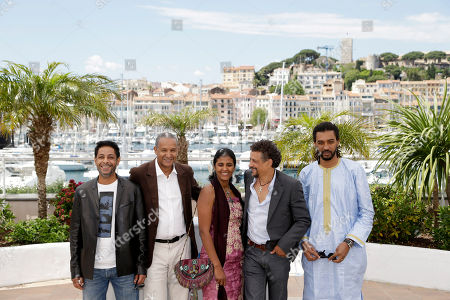 Hitchem Yacoubi, Abderrahmane Sissakoduring, Toulou Kiki, Abel Jafri, Ibrahim Ahmed dit Pino From left, actor Hitchem Yacoubi, director Abderrahmane Sissakoduring, actress Toulou Kiki, actor Abel Jafri and actor Ibrahim Ahmed dit Pino pose during a photo call for Timbuktu at the 67th international film festival, Cannes, southern France