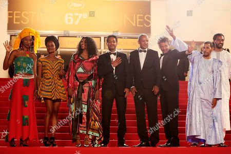 Hitchem Yacoubi, Abderrahmane Sissako, Abel Jafri, Ibrahim Ahmed dit Pino, Toulou Kiki From third left, actress Toulou Kiki, actor Hitchem Yacoubi, director Abderrahmane Sissako, actor Abel Jafri stand at the top of the steps as they arrive for the screening of Timbuktu at the 67th international film festival, Cannes, southern France