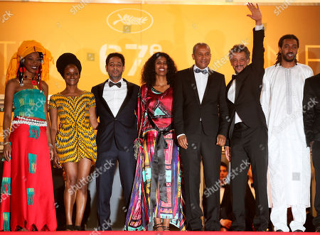 Hitchem Yacoubi, Abderrahmane Sissako, Abel Jafri, Ibrahim Ahmed dit Pino, Toulou Kiki From third left, actor Hitchem Yacoubi, actress Toulou Kiki, director Abderrahmane Sissako, actor Abel Jafri and actor Ibrahim Ahmed dit Pino stand at the top of the steps as they arrive for the screening of Timbuktu at the 67th international film festival, Cannes, southern France